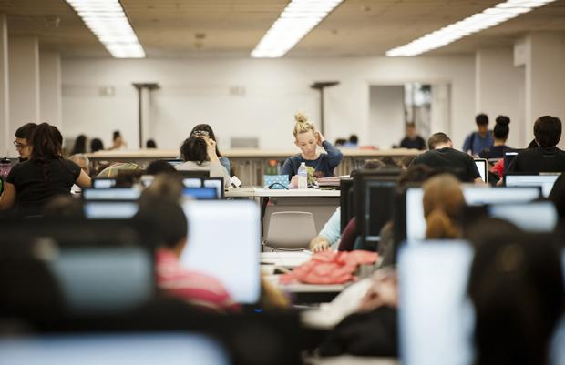 Communications major, Sable Potts, does homework at the Learning Commons at the Oviatt Library on Tuesday. The Oviatt experiences about 4,000 gate passes each day due to the increased student population and the new renovations. Photo credit: Charlie Kaijo / Senior Reporter