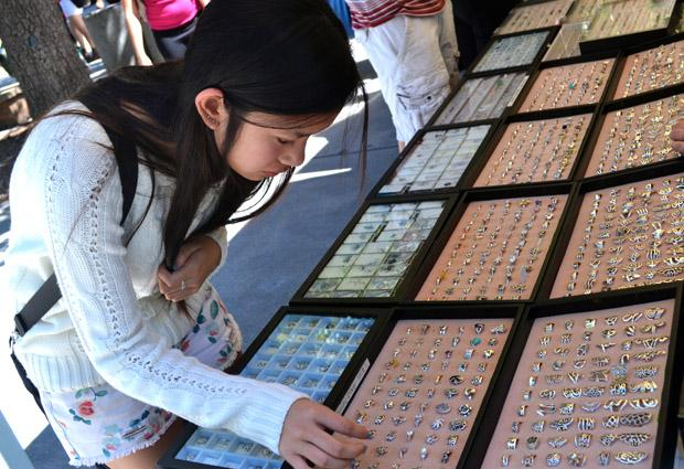 Ananya Chongpresertska, 18, a communications major, browses through an assortment of rings at one of the booths available at the Matador Mall, Monday. Photo credit: Victoria Becerril / Daily Sundial