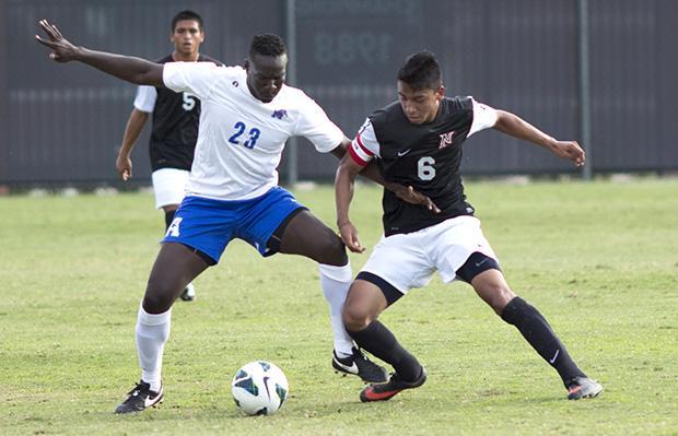 Senior midfielder Carlos Benavides battles a Memphis Defender
