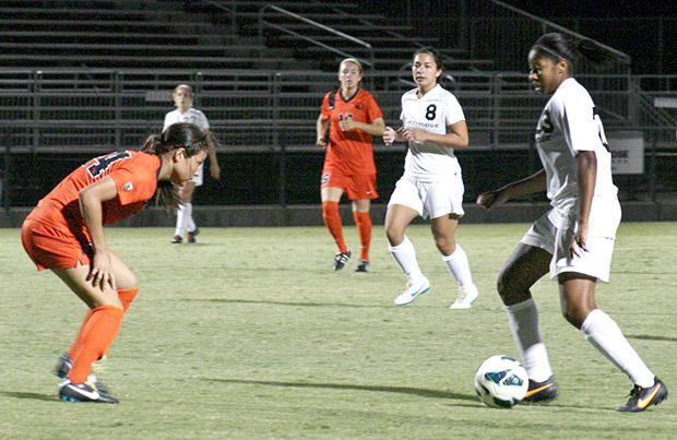 Freshman forward Breanna McCallum looks to dribble past an Oregon State defender. Photo Credit: Neelofer Lodhy / Daily Sundial