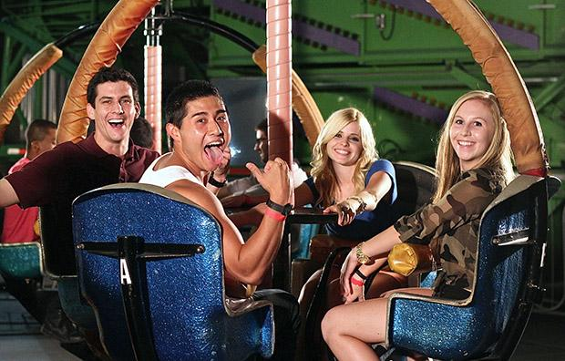 "Recreation and tourism management major Travis Hoogervorst, 24, exercise science major Mike Ho, 22, communication studies major Jessica Pimentel, 18, and biology major Jessica Gordon, 17, about to go on the spinning ""Tornado"" ride. Photo credit: Lucas Esposito / Daily Sundial"