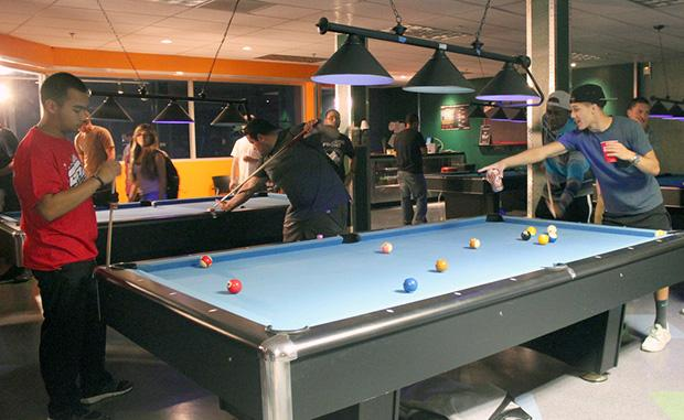 The Games Room and Veteran's Resource Center hosted Neon Nights in an attempt to build a community with students and gain support for their organizations. Students have access to a wide assortment of games like billiards. Photo credit: Ana Rodriguez / Daily Sundial