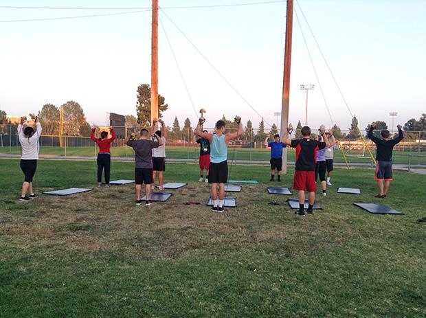 Participants line up and perform resistance training exercises. The Commit To Be Fit program meet every Monday through Thursday at 5 pm. Photo credit: Abigail Rondon / Daily Sundial