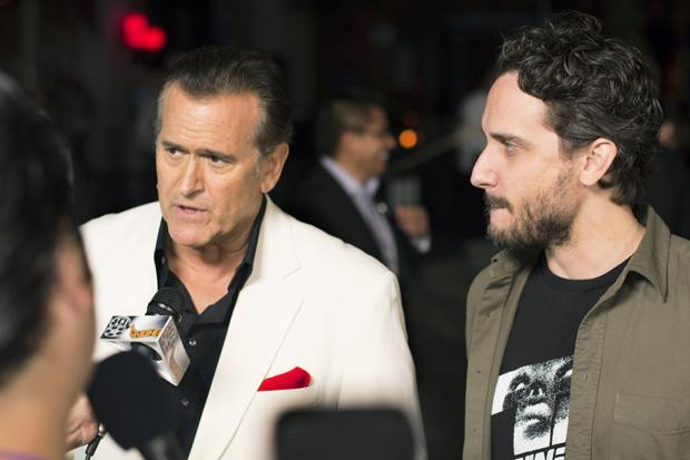 "Bruce Campbell of ""Evil Dead"" and Fedde Alvarez, director of the ""Evil Dead"" reboot, walk down the red carpet of the Eyegore awards during the opening night of Halloween Horror Nights at Universal Studios on Sept. 20, 2013. Photo credit: Trevor Stamp / Daily Sundial"
