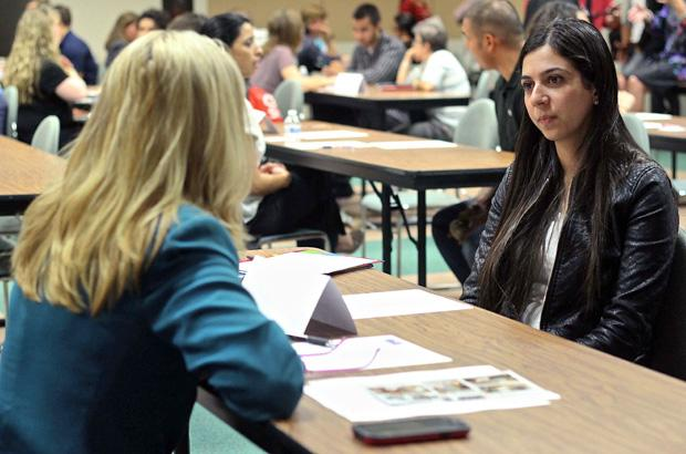 Sheida Rahmani (Right), 25, a graduate student in applied mathematics, listens intently to Cheryl Bhence (Left), a senior system engineer for Xerox Corporation. Photo credit: Lucas Esposito / Daily Sundial