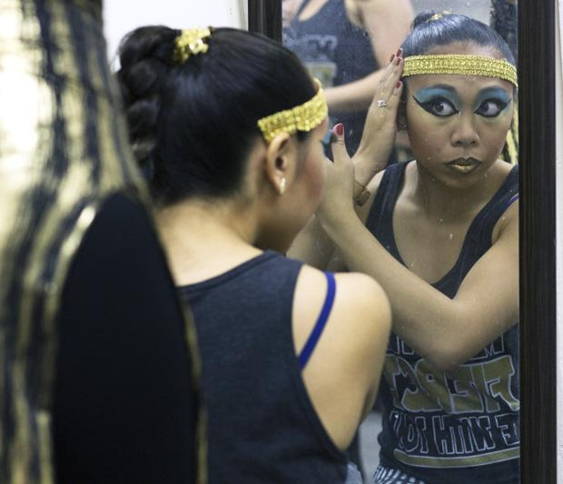 Kristel Dela Rosa, 22, junior kinesology major and member of the CSUN Hip Hop dance team, prepares to go on stage for the 12th Student Showcase in the Plaza Del Sol on Oct. 30, 2013. Photo credit: Trevor Stamp / Daily Sundial
