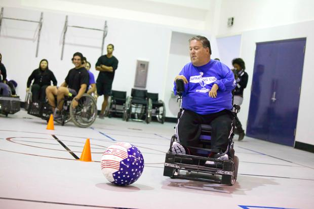 Steve Everett, the western regional director of the United States Power Soccer Association, shows kinesiology students how to spin-kick during a clinic in Redwood Hall. Photo credit: Loren Townsley / Daily Sundial