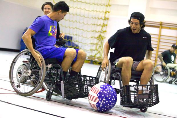 Kinesiology students Andreas Duran, 22, and Jesse Martinez, 21, from the Adapted Thereaputic Exercise class learned to play Power Soccer at a clinic held in Redwood Hall by four local athletes on Monday. Photo credit: Loren Townsley / Daily Sundial