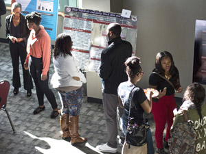 Pan-African Studies class present posters about issues facing colored men in today's society