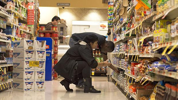 Belen Herrera, 21, junior urban studies major, and Travis White, 20, junior crimnology major and programs assistant for Unified We Serve (UWS), picked out food for a family UWS adopted for the holiday season on Nov. 25. Photo credit: Trevor Stamp / Daily Sundial