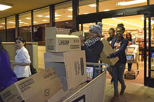 Members of Unified We Serve file out of a VONS grocery story before heading off to the organizations adopted family, the Garcia's house on Nov. 25. Photo credit: Alex Vejar / Daily Sundial