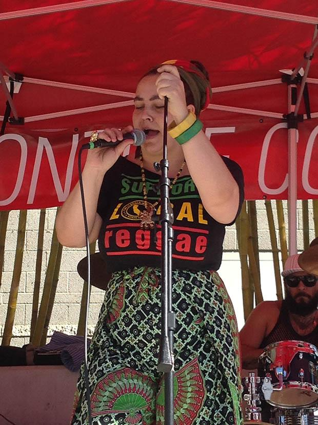 Amber Moghadam, a vocalist of ComeUnity Band, leads the group of reggae artists during the Noontime performance at the Plaza Del Sol, USU on Thursday. Photo credit: Jake Fredericks / Daily Sundial