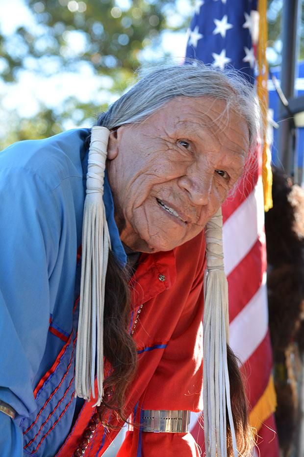 Saginaw Grant, head gourd dancer, blessed the powwow arena and it's dancers as well as lead attendees in prayer multiple times throughout the gathering. Photo credit: John Saringo-Rodriguez / Photo Editor