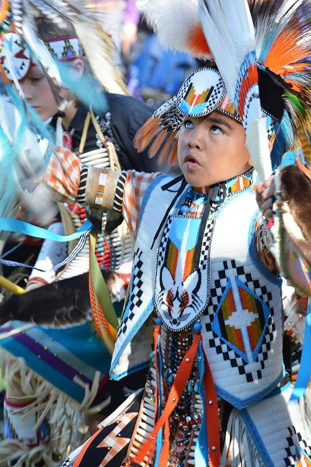 More than 40 dancers entered the arena in their American Indian regalia on Saturday. Photo credit: John Saringo-Rodriguez / Photo Editor