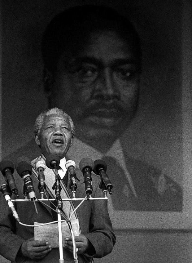 Nelson Mandela, in front of a giant portrait of Kenyan president Moi, speaks to a large crowd at Nairobi's Kasarani Stadium, during a tour of African countries after his release from prison in 1990. Photo credit: David Blumenkrantz / Contributor
