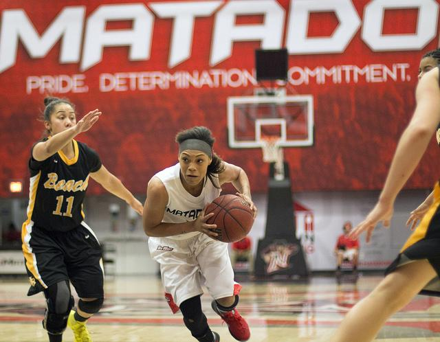 Junior guard Janae Sharpe drives through the Long Beach State 49ers' defense to reach the basket during the Matadors' 77-54 win at home Saturday.  Sharpe finished the game with 18 points.  Photo Credit: Trevor Stamp / Daily Sundial