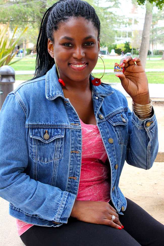 Precious Malumfashi, 26, shows the pin she received for participating on the Festival of Roses Parade on Jan. 1.