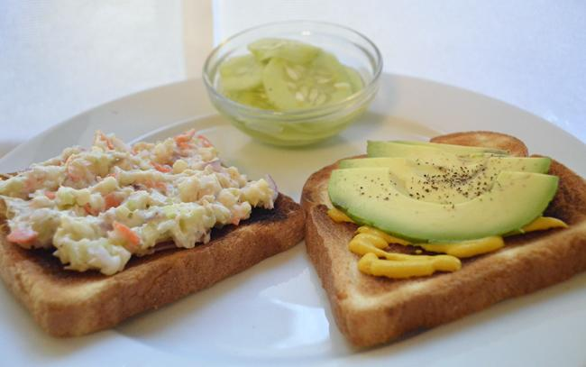 Albacore Tuna Salad Sandwich with Fresh Avocado and A Side of Pickled Cucumbers Makes for a refreshing, low-cal lunch.