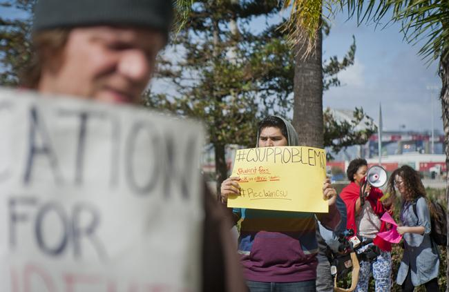 SQE members from various CSUs participate in a rally in front of the CSU Chancellor's Office in opposition to university success fees during the Board of Trustees meeting on Wednesday.  (Photo Credit:Charlie Kaijo/Senior Staff)