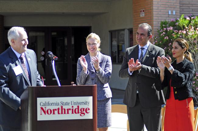 Kenneth Lord, Ph.D., left, the Dean, CSUN President Dianne F. Harrison, middle left, David Nazarian, middle right, with his wife, right, applaud as the ceremony has concluded. Nazarian has donated $10 million to the College of Business and Economics which CSUN has now named the college in dedication for his generous support at the naming ceremony on Thursday, March 27, 2014 in Cleary Court in front of Juniper Hall in Northridge, Calif. (Photo Credit: David J. Hawkins/PhotoEditor)
