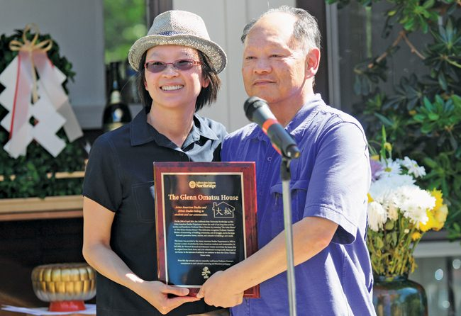 Glenn Omatsu, right, receives a plaque from Gina Masequesmay, the Chairman of the Asian American Studies (AAS) at the AAS reception and dedication ceremony to rename the formerly known Asian House to the Glenn Omatsu House on April 29, 2014 in Northridge, Calif. (Photo Credit: David J. Hawkins/Photo Editor)