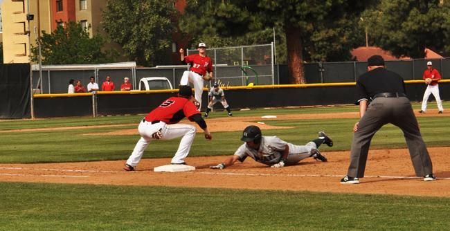 Matadors Brycen Rutherford (Center) throws the ball to the first base to  William Colantono (Bottom Left) as Hawaii's player leaps for the base. (Photo Credit: Zuying Chen / Contributor)