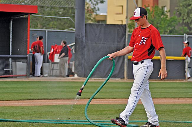 Baseball players pitch in to clean up Matador Field