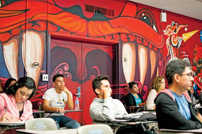 Students in class in front of the mural during a Chicana/o Studies 111 Chicanos in the Arts lecture by professor Maria Elena Fernandez on April 18 at the Jerome Richfield Hall in Northridge, Calif. Photo Credit by David J. Hawkins.