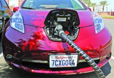 A Nissan LEAF uses one of the two charging stations located in the F5 parking lot, Apr. 21. They are the only fast-charge stations on campus and can charge a drive range between 60 to 80 miles in about 20 minutes. Photo Credit: Lucas Esposito / Daily Sundial