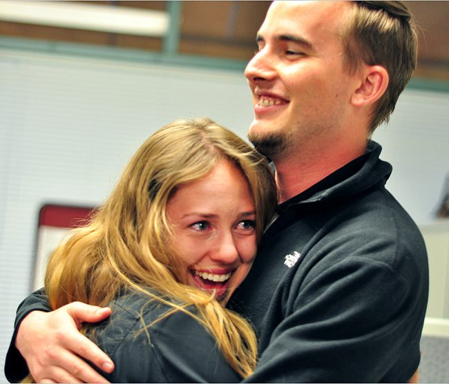 Tiffany Zaich celebrates her new position as AS president for 2014-2015 school year with the current AS president Christopher Woolett on Wednesday.
