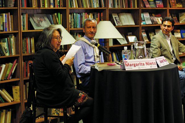 Javier Rico and Israel Ramirez listen to Margarita Nieto read her essay about Mexican writer Octavio Paz's life.