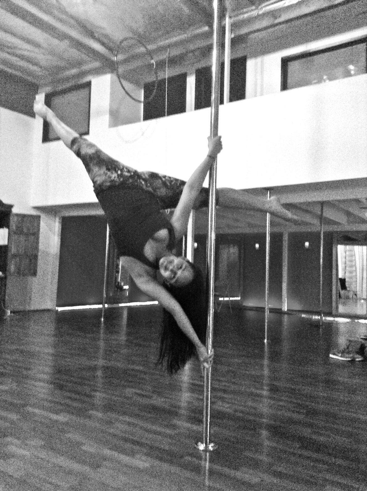 Nicolo Socola/Daily Sundial Sergia Louise Anderson, owner of The Vertitude, a pole dancing studio, shows off her talent with an aerial pose.