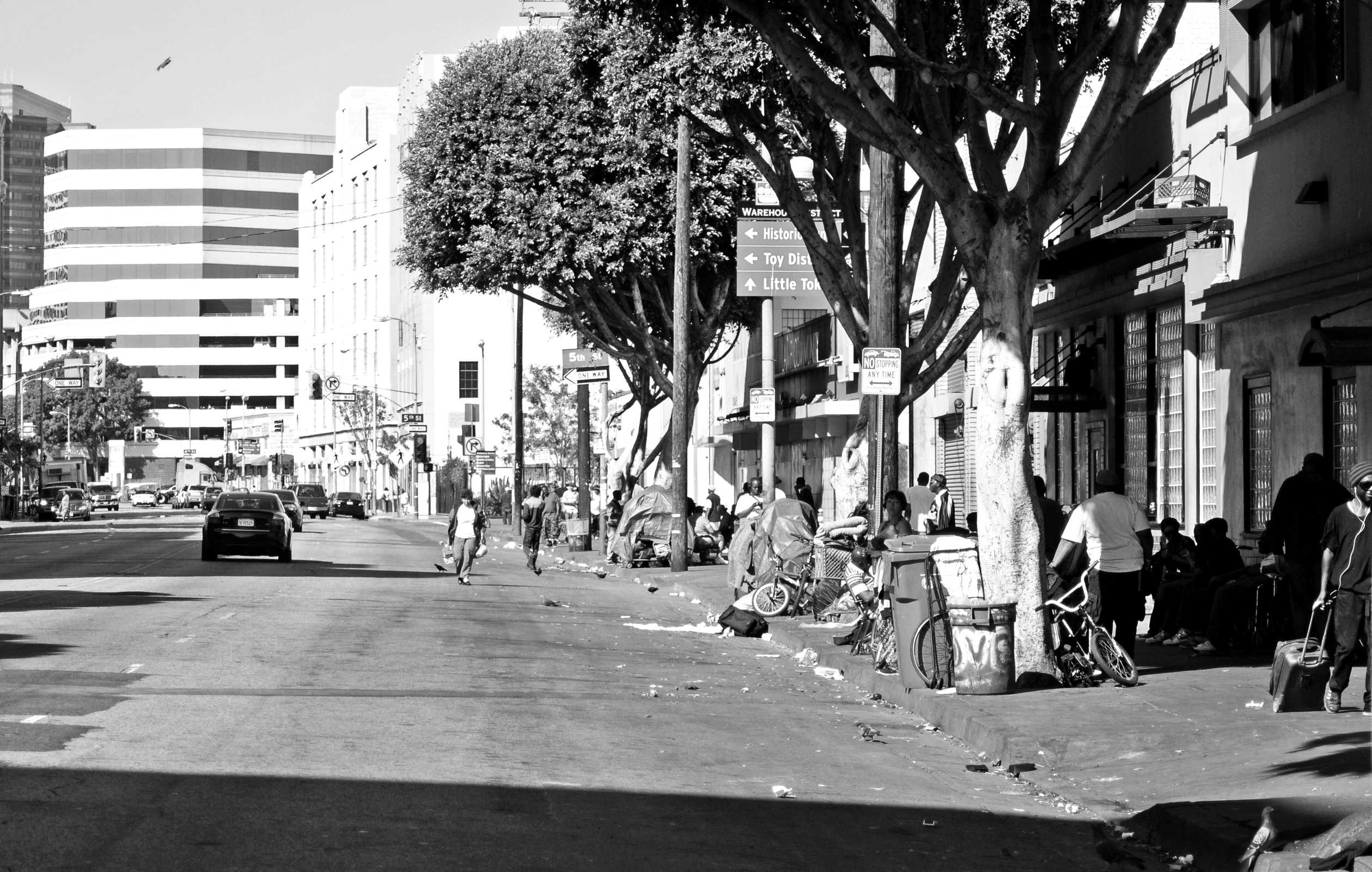 The stark contrast between the affluent businessmen and those living in poverty in Los Angeles can be seen literally across the street from each other. Photo credit: David J. Hawkins/Photo Editor