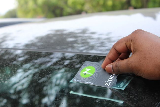 Samuel Boppuri, electrical engineer grad student, made a reservation to use the Zipcar Saturday morning. Placing the zipcar card on top of the zipcar sticker unlocks and locks the car. The Zipcars do offer their services on weekends.