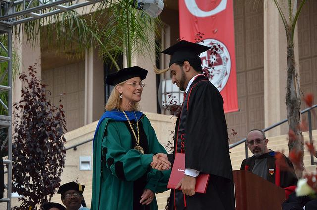 A+graduate+from+the+David+Nazarian+College+of+Business+and+Economics+is+congratulated+by+President+Dianne+Harrison+during+commencement+ceremonies+at+the+Oviatt+Lawn+Thursday+morning.+Photo+Credit%3A+Vincent+Nguyen+%2F+Contributor
