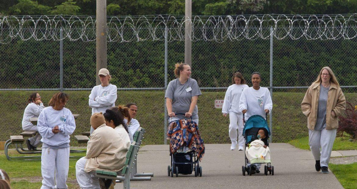 Women+prisoners+are+taking+their+babies+for+a+walk.+However+for+some%2C+they+have+been+denied+the+privilege+of+walking+their+own+child.+Courtesy+of+MCT+