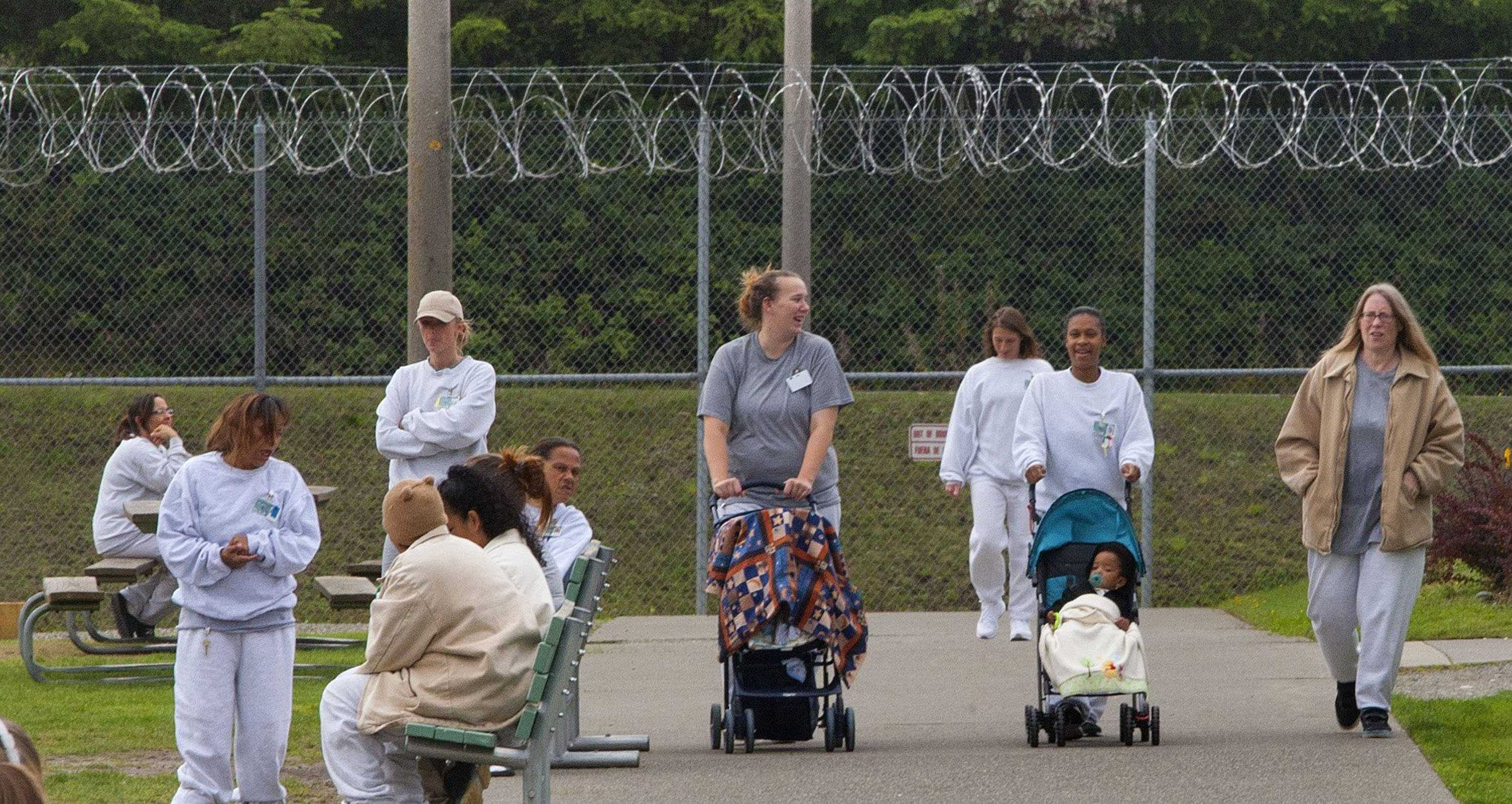Women prisoners are taking their babies for a walk. However for some, they have been denied the privilege of walking their own child. Courtesy of MCT