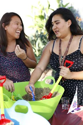 Vanessa Sun, 21,left, and Anna Phangkhayan, 25, Biology Seniors playing in the sand box at the pool side Matafest located at the SRC pool on Thursday, August, 28, 2014 in Northridge, Calif. Photo Credit: David J. Hawkins/ The Sundial