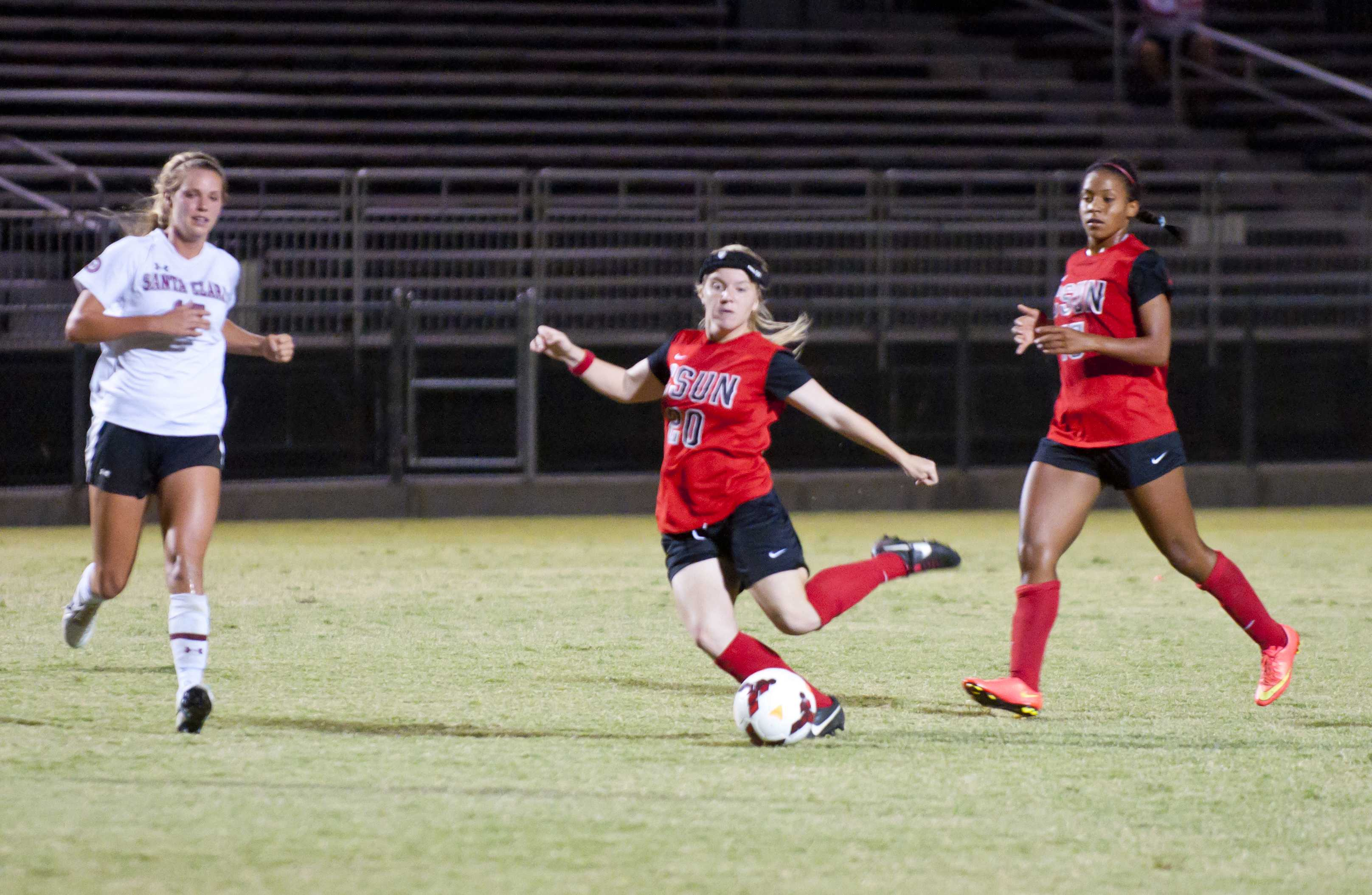 Matadors Kourtney Kutscher, center, tries to score as the Broncos midfielder Dani Weatherholt, left, races to the ball in the first half at the Matador Soccer Field on Friday, September 26, 2014 in Northridge, Calif. With the game resulting a 1-0 loss against the Santa Clara Broncos who proved to be a strong defensive team with a 5-4 record with no losses as the Matadors press on with several offensive plays despite the Broncos 5 saves the Matadors were unable to score. (Photo Credit: David J. Hawkins/The Sundial)