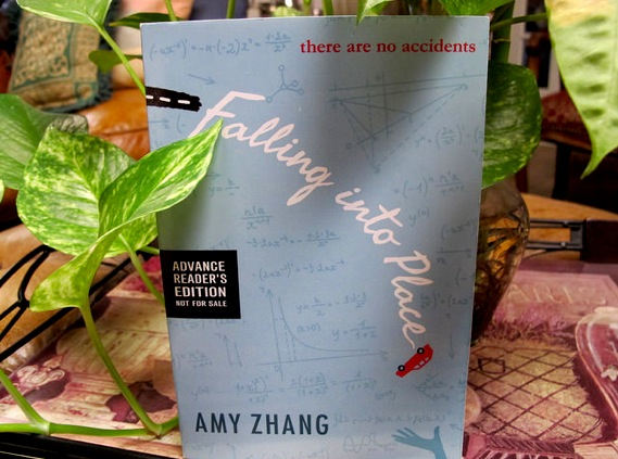 Falling Into Place by Amy Zhang, a recent high school graduate, is a novel that focuses on the harsh realities that high schools kids undergo. When student Liz Emerson drives her Mercedez- Benz into a tree, questions arise on why the most popular girl in school would commit such an act. Photo by Sarah Reyes/ Contributor