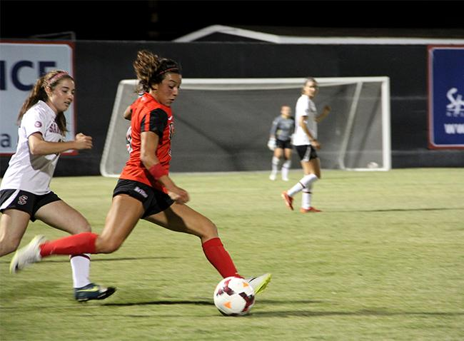 Cynthia Sanchez, wins over the ball from Santa Clara's player. Despite having shots on goal and good plays the Matadors lose to the Broncos 1-0. Photo Credit: Victoria Lopez/Contributor