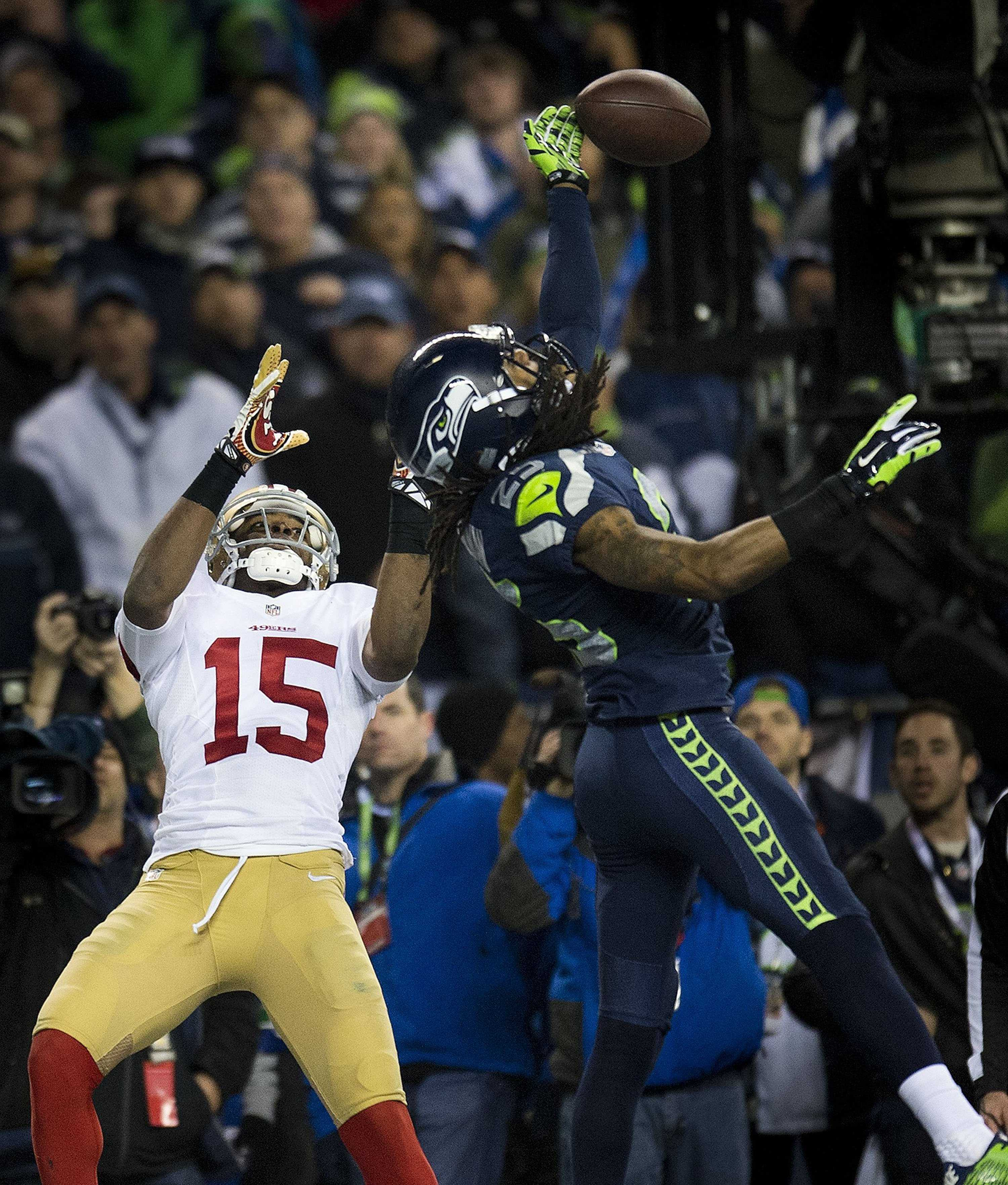 The Seattle Seahawks and San Francisco 49ers are still the class of the NFC, but both have questions to face in 2014.