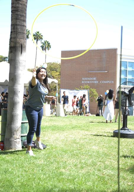 Itzel Quezada, freshman undecided major, plays a ring toss game during the EOP 45th celebration event on Sept. 16, 2014 on the Matador Bookstore lawn at CSUN. Photo Credit: Alex Vejar/ The Sundial