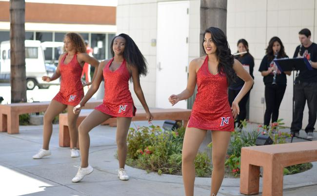 Members of the CSUN cheerleading team performs outside of the Matadome during the Blacktop at the Matadome event on Thursday, Sept. 18, 2014. Photo Credit:Alex Vejar/The Sundial