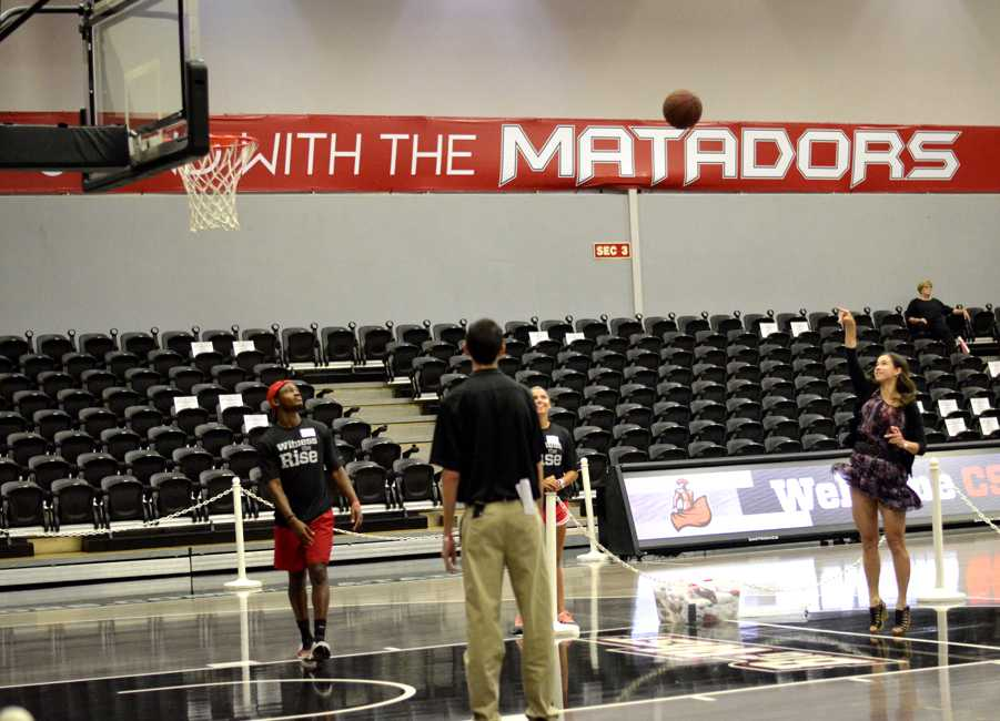 Michelle Almazan (far right), academic advisor for the CSUN basketball teams, shoots a basket in attempt to win a T-shirt during the Blacktop at the Matadome event on Thursday, Sept. 18, 2014. Photo Credit: Alex Vejar/The Sundial