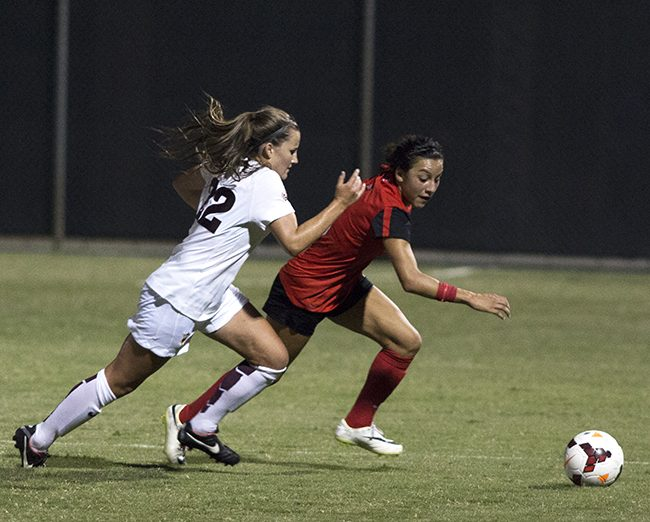 Sophomore Cynthia Sanchez charges for the ball against an Arizona State player during Friday night's game. The Matadors fell to the Sun Devils, 2-0. Photo credit: Trevor Stamp/The Sundial