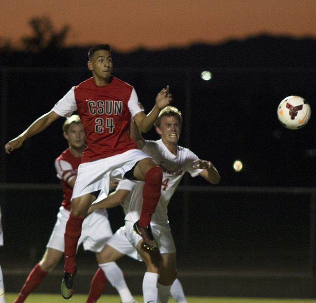 Junior Carlos Gonzalez tries to get a shot on goal from a corner kick during the Matadors' home opener on Friday night. The Matdors lost 1-0 to the New Mexico Lobos. Photo credit: Trevor Stamp/The Sundial