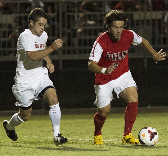 Junior Marino Peixoto dribbles his way through the New Mexico Lobos' defense for the Matadors in their home opener on Friday night. The Matadors had no luck scoring a goal, falling 1-0. Photo credit: Trevor Stamp/ The Sundial