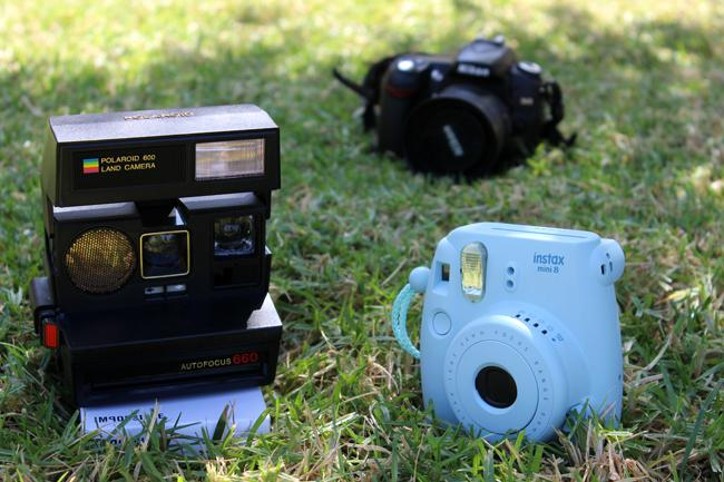 Polaroid cameras are becoming popular once again. Quick photos are produced by polariods and the cameras today like the Instax mini 8, are more portable and inexpensive than most DSLR cameras. Photo Credit: Araceli Castillo/ Photo Editor