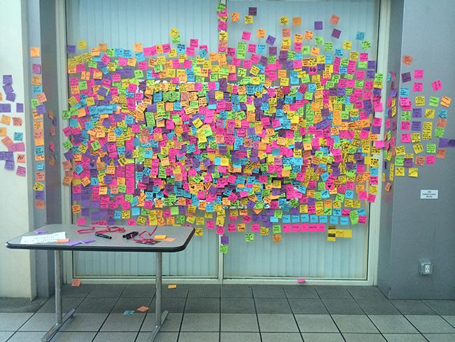 The community of CSUN students came together to write notes of hope to spread awareness of the suicide outside the Matador Bookstore, Tuesday Sept. 16. The amount of notes posted was a reminder to always keep fighting through all obstacles. Photo Credit: Jessica Ferrufino/Contributor